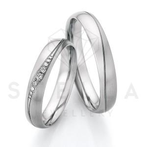 2 x Stahl Trauringe mit Diamanten zus. ca. 0,036ct.  -...