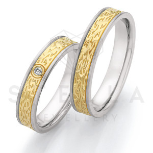2 x Stahl/585er Gold Trauringe mit Diamant ca. 0,035ct....